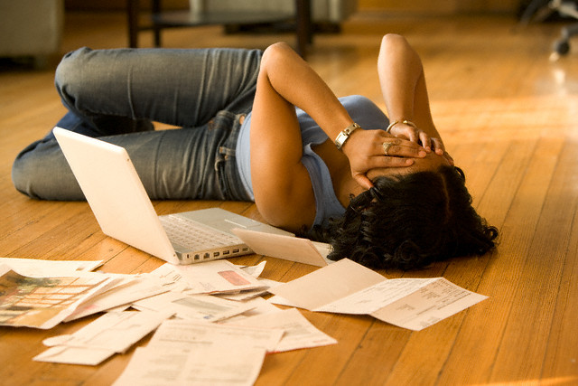 Overwhelmed Woman Paying Her Bills --- Image by © John Henley/Corbis