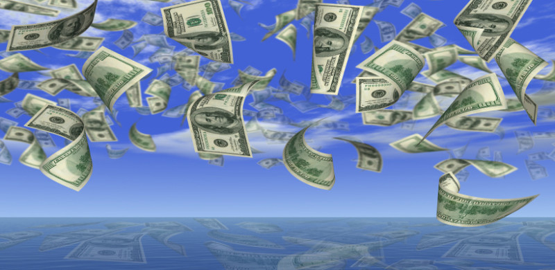 Falling 100 dollar banknotes on a background of the sky in ocean