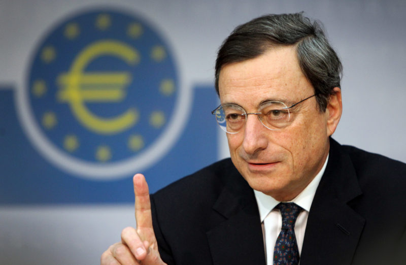 """The European Central Bank's new chief Mario Draghi gestures during his first press conference at the ECB in Frankfurt/M., western Germany, on November 3, 2011. The European Central Bank's decision to cut its key interest rates in a surprise move was """"unanimous"""", the 64-year-old Italian said. Draghi's first few days as ECB president have certainly been a baptism of fire. The 17-nation eurozone is back in deep crisis following the shock call by Greece for a national referendum on a debt rescue reached with huge difficulty only last week. Draghi took over at the helm of the ECB from Jean-Claude Trichet.     AFP PHOTO / DANIEL ROLAND (Photo credit should read DANIEL ROLAND/AFP/Getty Images)"""